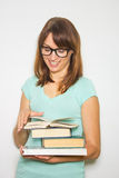 Young female student with books on white. Stock Photography