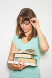 Young female student with books on white. Royalty Free Stock Photo