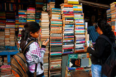 Young female student choose the book on the street market Stock Photo
