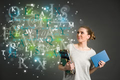 Young female student with clouds of bright formulas, numbers, le Stock Images