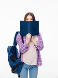 Young female student covering face with book Stock Photo