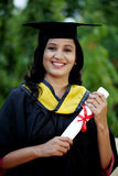 Young female student with diploma at outdoors Royalty Free Stock Image