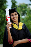 Young female student with diploma at outdoors Royalty Free Stock Images