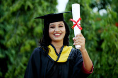 Young female student with diploma at outdoors Stock Images