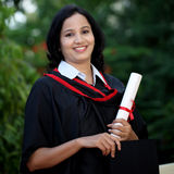 Young female student with diploma at outdoors Stock Photo