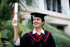 Young female student with diploma at outdoors Royalty Free Stock Photos