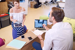 Young female student getting mentored by senior male mentor Stock Photography