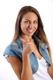 Young female student giving a thumbs up gesture Royalty Free Stock Photography