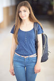 Young female student back to school. Happy female student at the university Royalty Free Stock Images