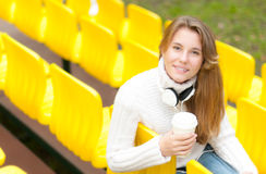 Young female student having rest outdoor. Stock Photo