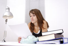 Young female student at her desk Stock Photo