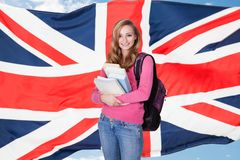 Young female student holding books Royalty Free Stock Image