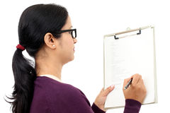 Young female student holding clipboard Stock Photos