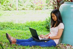 young female student with a laptop computer in th Stock Images