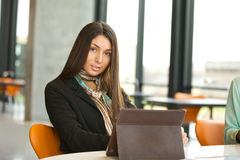 Young female student at library with digital tablet Stock Photography
