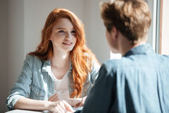 Young female student listening her friend Royalty Free Stock Images