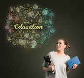 Young female student looking at  education clouds Royalty Free Stock Photography