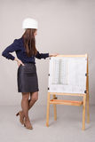 Young female student is looking at a multi-storey project Royalty Free Stock Photo