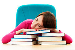 Young female student with many  books Royalty Free Stock Photography