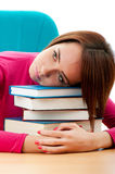 Young female student with many  books Stock Photos