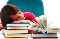 Young female student with many  books Stock Photo