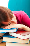 Young female student with many  books Royalty Free Stock Images