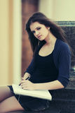 Young female student with notebook on campus Royalty Free Stock Photos
