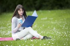Young female student in the  park Royalty Free Stock Images