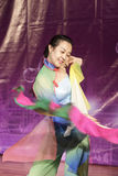 Young female student perform folding fan dance Royalty Free Stock Photos