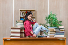 The young female student preparing for college school exams Stock Image