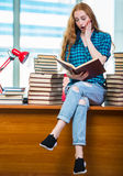 The young female student. Young female student preparing for exams Royalty Free Stock Photos