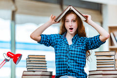 The young female student preparing for exams. Young female student preparing for exams Stock Photography