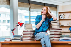 The young female student preparing for exams Royalty Free Stock Image