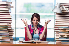 The young female student preparing for exams Stock Images