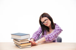Young female student push out books Stock Photos
