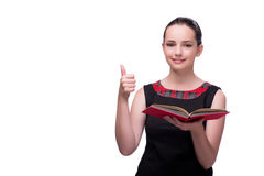 The young female student reading book isolated on white. Young female student reading book isolated on white Stock Photo