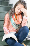 Young female student reading a book Stock Photos
