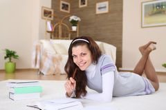 A young female student reading at home Stock Photography