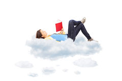 Young female student reading a novel and lying on clouds. On white background Royalty Free Stock Photo