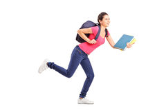 Young female student rushing forwards Stock Photography
