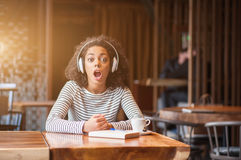 Young female student is screaming in cafe Royalty Free Stock Photography