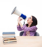 Young female student shouting in megaphone Royalty Free Stock Image