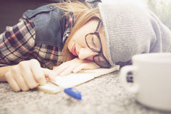 Young female student sleeping Stock Images