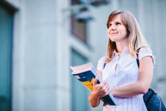 Free Young Female Student Standing Near University Holding Books Royalty Free Stock Images - 44583479