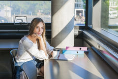 Young female student in study area Stock Images