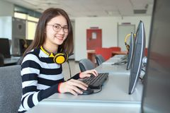 Young female student study in the school library, She using laptop and learning online, Back to school education knowledge college stock image