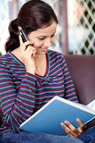 Young female student talking on cellphone Stock Photo