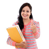 Young female student with thumbs up gesture Royalty Free Stock Photography