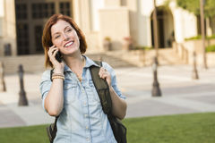 Young Female Student Walking Outside Using Cell Phone Stock Photos