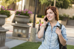 Young Female Student Walking Outside Using Cell Phone Royalty Free Stock Photo